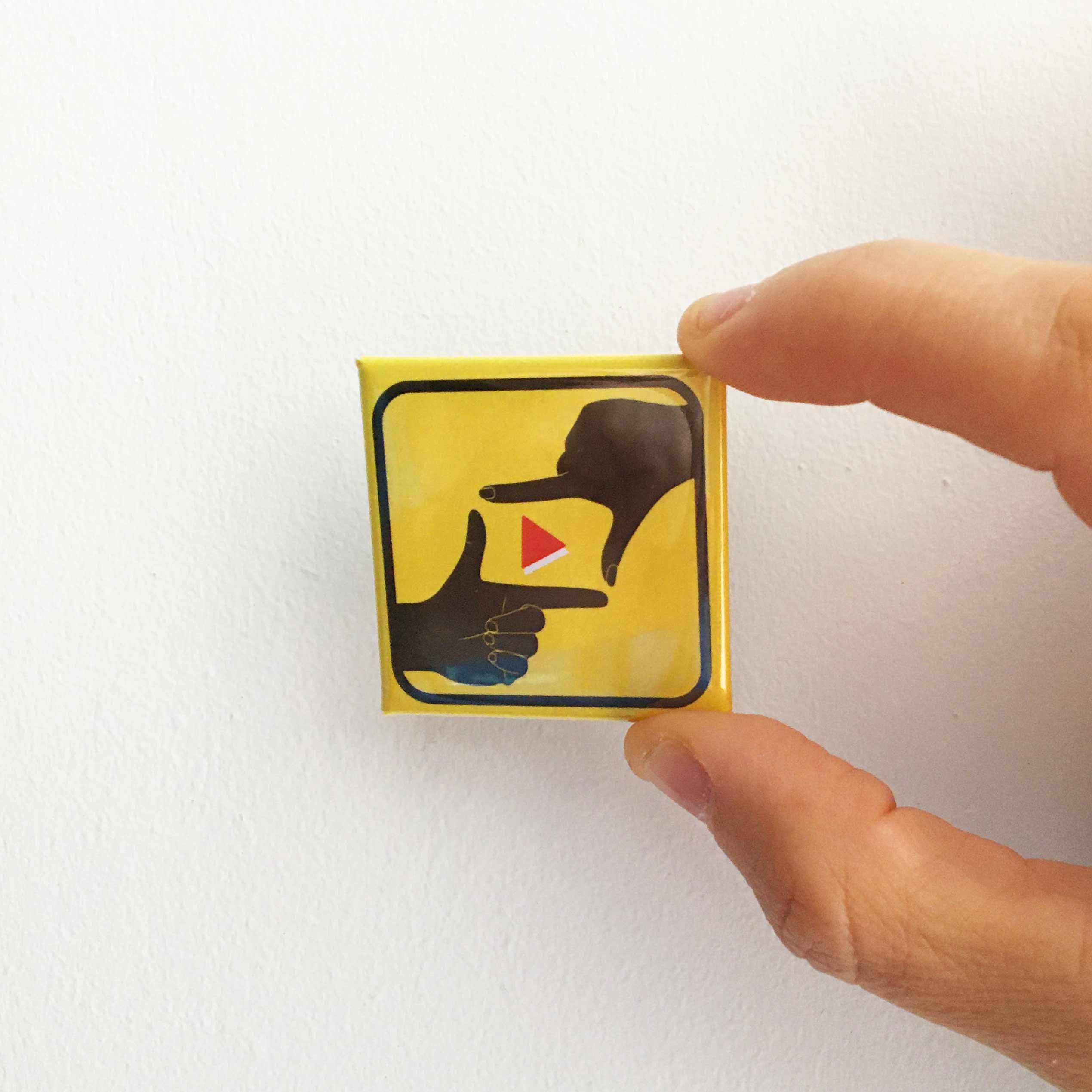 Le badge A Portée Deux Mains